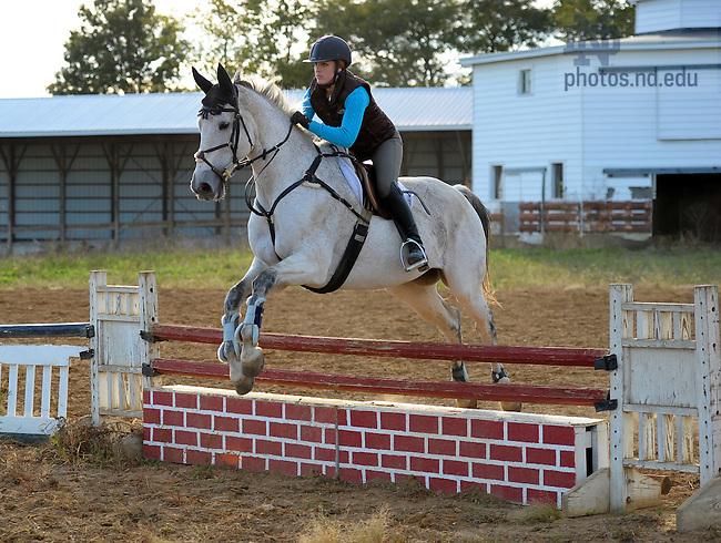 Mia Genereux takes Slice over a jump at St. Joseph Farm...Photo by Matt Cashore/University of Notre Dame