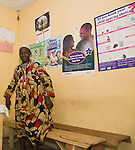 A public health clinic on Agboyi-Ketu island in Lagos displays family planning and safe drinking water messages from Nigeria's largest indigenous NGO, the Society for Family Health.
