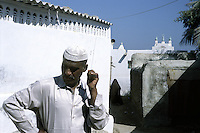 Outside a local mosque in the back alleys of the port city of Gwadar.  Once a part of the Sultanate of Oman, Gwadar was given to Pakistan in 1958 but still retains strong elements of its Arabic character and culture.  It is also once of the towns in the Makran region where people of African descent can still be found.  It is also home to a unique Islamic sect called the Zikris
