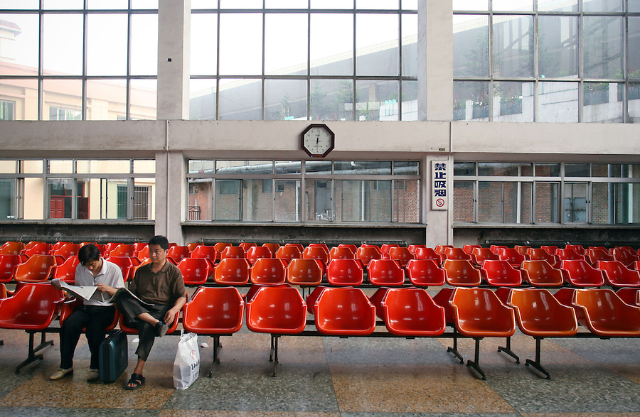 Passengers wait to board a train at the Dandong station in northeastern Liaoning Province. Still the cheapest mode of transport, most Chinese travelers prefer to take the train to flying.