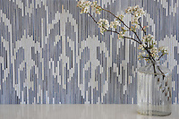 Weft, a handmade mosaic shown in Quartz and Pearl jewel glass, is part of the Ikat Collection by Sara Baldwin New Ravenna.<br />