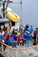 Passengers listening to Instructions from Captain on Whale Watching Boat at Telegraph Cove, on Vancouver Island, British Columbia, Canada