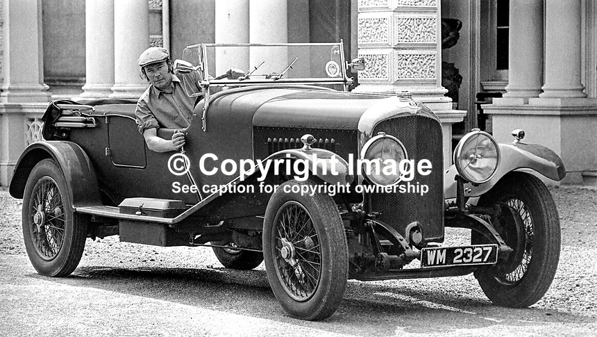 Henry Mulholland, 4th Lord Dunleath, Ballywalter, Co Down, N Ireland, at the wheel of an open-top Bentley in front of Ballywalter Park Mansion House. 197507000569a.<br />