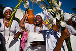 Brazilians celebrate their annual tribute to Yemanja, the goddess of the sea in the Afro-Brazilian religion Candomble, offering flowers, food and perfume, as drums belted out African rhythms, during a pre-Carnival celebration in Rio de Janeiro, Brazil, Saturday, Feb. 2, 2013.