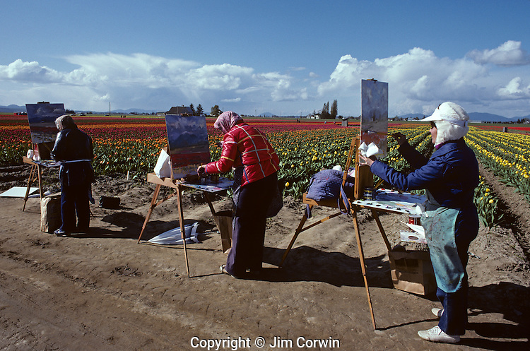 Artists painting tulip fields standing in a row