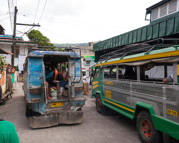 Jeepneys board for the trip between Sampaloc and nearby towns. (Sampaloc, Quezon Province, the Philippines.)