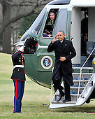 United States President Barack Obama salutes a U.S. Marine as he arrives on the South Lawn of the White House in Washington, D.C. following a quick trip to Cleveland, Ohio to discuss the economy..Credit: Ron Sachs / Pool via CNP