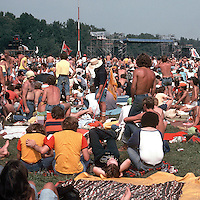 The left portion of Image C50-29. Scenes of the audience at the Labor Day Weekend Grateful Dead Concert, Englishtown NJ, 3 September 1977. The Stage in the distance and a Sound Relay Tower in the scene.
