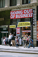A men's clothing store store on Broadway in Lower Manhattan in New York on Saturday, May 12, 2012 announces that it is soon going out of business. (© Richard B. Levine)
