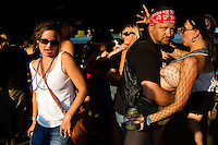 "Revelers dance to live music at the Testicle Festival at the Rock Creek Lodge in Clinton, MT.  Among the songs played was ""Sweet Home Montana,"" a take on the classic rock song ""Sweet Home Alabama."" The Rock Creek Lodge in Clinton, MT, has hosted the annual Testicle Festival since the early 1980s.  The four day festival and party revolves around the consumption of so-called Rocky Mountain Oysters, which are deep-fried bull testicles."