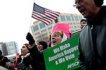 Union worker Lynn LaFrancois-de la O and other protestors chant outside a business owned by the Koch brothers, who many protestors believe have influenced Wisconsin Gov. Scott Walker in his efforts to curb unions in Madison, Wisconsin, February 24, 2011.