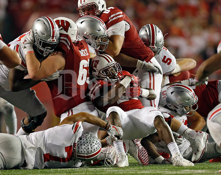Ohio State Buckeyes cornerback Damon Webb (7) makes a tackle against Wisconsin Badgers running back Dare Ogunbowale (23) in the 4th quarter during their game at Camp Randall Stadium in Madison, Wis on October 15, 2016.  (Kyle Robertson / The Columbus Dispatch)