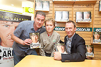 NO REPRO FEE.8/10/2011. Eason, Ireland's leading retailer of books, stationery, magazines and lots more, hosted a book signing by Jockey, Paul Carberry.  Pictured at Eason, O'Connell Street, Dublin are fans Brendan and Liam 11 Hayes from Galway with Paul Carberry who signed copies of his new autobiography One Hell of a Ride. Follow Eason on Twitter - @easons For further information, please contact: Aoife McDonald WHPR 087 4100777 . Picture James Horan/Collins Photos
