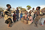 Children gather to sing and dance in the Southern Sudan village of Yondoru. Families here are rebuilding their lives after returning from refuge in Uganda in 2006 following the 2005 Comprehensive Peace Agreement between the north and south. NOTE: In July 2011, Southern Sudan became the independent country of South Sudan