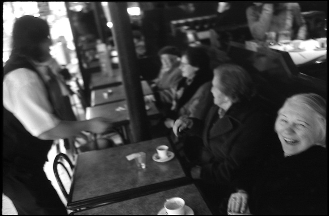 Elderly women gather daily to share small talk and laughter at a Café in Paris' 17th Arrondissement.