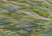 A closeup abstract look at water flowing down the Tobacco River in Montana