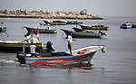 Palestinian fishermen ride their boats during a rally marking the third anniversary of attack on the Turkish flotilla Mavi Marmara at Gaza seaport on May 31, 2013. Turkey broke off diplomatic relations with Israel in 2010, after the IDF (Israeli Defence forces) raided the ship Mavi Marmara as it attempted to break Israel s naval blockade of Gaza, killing nine Turkish activists on board. Photo by Ashraf Amra