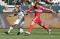 LA Galaxy Landon Donovan attempts to move past Chicago Fire Krzysztof Krol. The Chicago Fire beat the LA Galaxy 3-2 at Home Depot Center stadium in Carson, California on Sunday August 1, 2010.