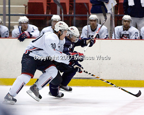 Ben Ryan (US/Notre Dame - Brighton, MI) and Blake Geoffrion (US/UWisconsin - Brentwood, TN) take part in the Team White/Team Blue scrimmage. USA Hockey puts on a national junior evaluation camp each August to help determine members of the US Under-20 team for the World Juniors tournament and invites enough players to make up two teams, Team White and Team Blue.  The two teams scrimmage twice prior to playing Finland and Sweden and in their second meeting on Monday, August 6, 2007, Team White defeated Team Blue 4-3 at the 1980 Rink in Lake Placid, New York.