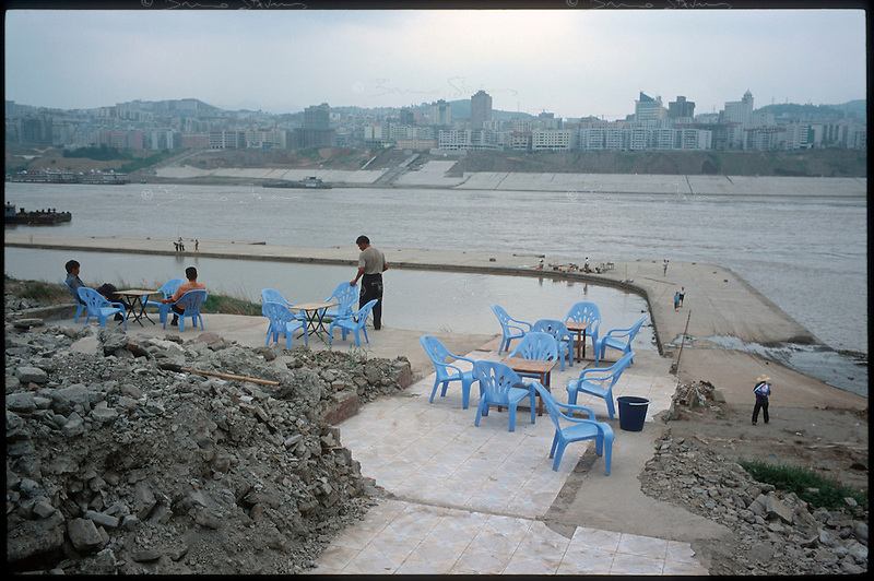 Fengdu, China, August 2003.A terrace near a jetty in the old city of Fengdu, already half-destroyed to allow the Three Gorges Dam project to be completed; the next day, the water level had risen well above the jetty now totally submerged.