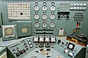 8/28/2008--Hanford, WA, USA..THe central control panels in the control room of the B-Reactor at the Hanford Site, Washington, along the banks of the Columbia River. ..The reactor was the first large scale plutonium production reactor ever built and started production in December, 1944. The project was commissioned under the Manhattan Project, during World War II, to develop the first nuclear weapons. The B-Reactor was shut down in 1968 and on August 25th, 2008, was declared a National Historic Landmark and is now open to tourists...The reactor was graphite moderated and water cooled. It consisted of a 28 by 36-foot, 1,200-ton graphite cylinder lying on its side, penetrated through its entire length horizontally by 2,004 aluminum tubes, the ends which can be seen here. Two hundred tons of uranium slugs the size of rolls of quarters and sealed in aluminum cans went into the tubes...During the Cold War, the Hanford project was expanded to include nine nuclear reactors and five massive plutonium processing complexes, which produced plutonium for most of the 60,000 weapons in the U.S. nuclear arsenal. The weapons production reactors were decommissioned at the end of the Cold War, but the manufacturing process left behind 53 million U.S. gallons of high-level radioactive waste that remains at the site. Hanford is the most contaminated nuclear site in the United States and is the focus of the nation's largest environmental cleanup, providing thousands of jobs to residents in nearby towns such as Richland...©2008 Stuart Isett. All rights reserved.