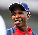 3 July 2009: Washington Nationals' center fielder Nyjer Morgan recently acquired from the Pittsburgh Pirates, smiles while taking his first batting practice with the Nats prior to a game against the Atlanta Braves at Nationals Park in Washington, DC. The Braves defeated the Nationals 9-8, to take the first game of the 3-game weekend series. Mandatory Credit: Ed Wolfstein Photo
