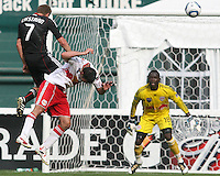 Adam Cristman #7 of D.C. United heads high over Mike Petke #12 of the New York Red Bulls during an MLS match on May 1 2010, at RFK Stadium in Washington D.C.