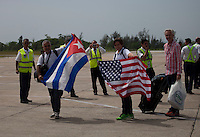 SANTA CLARA, CUBA - AUGUST 31 : Tourists waves Cuban and U.S. flags after arrival a Jet Blue commercial flight between the US and Cuba during inaugural flight at Abel Santamaría Airport on August 31, 2016 in Santa Clara, Cuba. Photo by VIEWpress