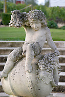 Statue of Bacchus, grape bunch. In the garden. Chateau Malartic Lagraviere, Pessac Leognan, Graves, Bordeaux, France