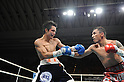 (L-R) Hiroyuki Hisataka (JPN), Hugo Cazares (MEX), DECEMBER 23, 2010 - Boxing : Hugo Fidel Cazares of Mexico in action against Hiroyuki Hisataka of Japan during the 5th round of the WBA super flyweight title bout at Osaka Prefectural Gymnasium in Osaka, Osaka, Japan. (Photo by Mikio Nakai/AFLO).