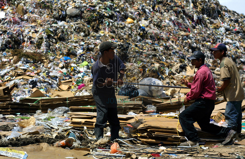 People gather recyclable materials in a massive trash dump in Guatemala City, Guatemala.