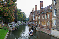 UK, England, Cambridge.  Punting on the River Cam by the Mathematical Bridge, Queen's College.