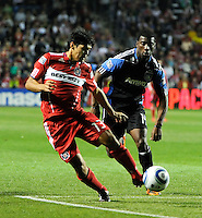 Chicago Fire defender Deris Umanzor (13) beats San Jose midfielder Brandon McDonald (14) to the ball during the second half of a match between the San Jose Earthquakes and the Chicago Fire at Toyota Park in Bridgeview, IL on April 10, 2010.  San Jose Earthquakes 2, Chicago Fire 1.