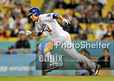 23 July 2011: Los Angeles Dodgers infielder Jamey Carroll singles to put runners at first and second in the bottom of the 9th inning during a game against the Washington Nationals at Dodger Stadium in Los Angeles, California. The Dodgers rallied to defeat the Nationals 7-6 on a Rafael Furcal walk-off, RBI double in the bottom of the 9th inning. Mandatory Credit: Ed Wolfstein Photo