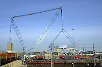 Crane preparing to Pick Completed Steel Bridge in place over New Haven CT Rail Yard and active Amtrak and Metro-North Commuter Train tracks.