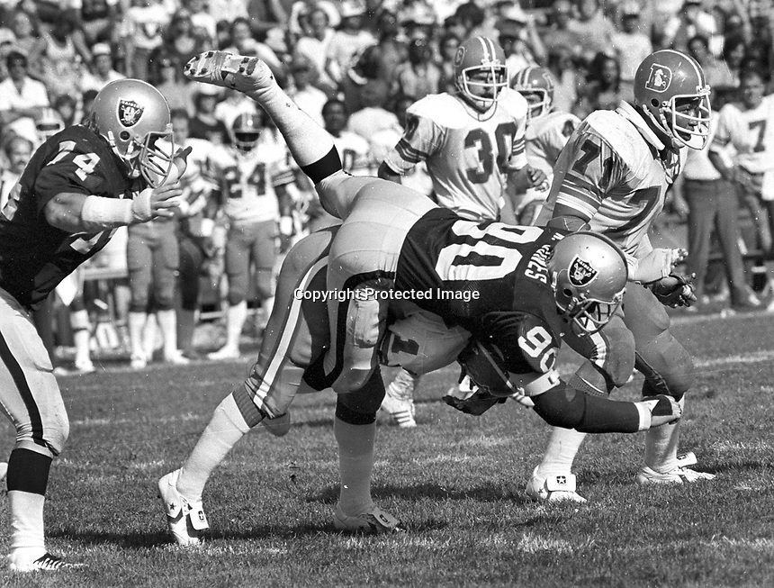 Oakland Raider Willie Jones smothers Denver QB#14<br />