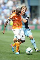 Oscar Boniek Garcia (27) midfield Houston Dynamo holds of the challengre from Seth Sinovic (15) defender Sporting KC .Sporting Kansas City and Houston Dynamo played to a 1-1 tie at Sporting Park, Kansas City, Kansas.