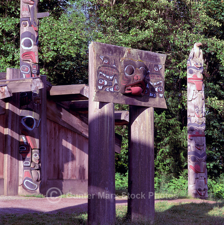 Haida Totem Poles and Plank House at Museum of Anthropology, University of British Columbia (UBC), Vancouver, BC, British Columbia, Canada.  Double Mortuary Pole (foreground) and Haida Mortuary House.