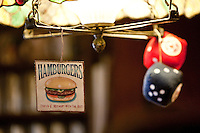 A hamburger sign hangs of a light at Louis' Lunch in New Haven, CT, USA, 26 May 2009.