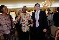 British Chancellor of the Exchequer Gordon Brown (R), former South African president Nelson Mandela (C) and Mandela's wife Graca Machel (L) at the presidential palace in Maputo after talks on education in Africa. Brown was in Mozambique to launch a new 'Free education for all' initiative...