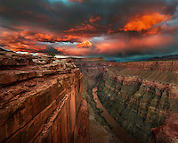 The afterglow of the setting sun illuminates the Colorado River under Toroweap, a remote location in the Grand Canyon.