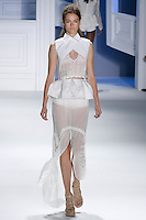 Jac walks runway in a White silk-linen striped v-neck top with white mackintosh cotton cross cross cotton collar overlay and drawstring peplum, and White silk chiffon sheer drawstring Mack skirt, by Vera Wang, for the Vera Wang Spring 2012 collection, during Mercedes-Benz Fashion Week Spring 2012.
