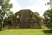 Great Pyramid in the Mundo Perdidio or Lost World complex, Maya ruins of Tikal, El Peten, Guatemala. Tikal is a UNESCO World Heritage Site....