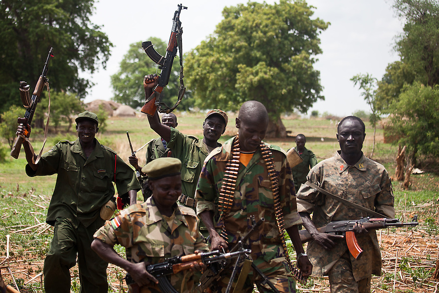 SPLA soldier near Dalami show off weapons they captured in a recent battle with SAF troops. The SPLA say they have surrouned Dalami and cut off all suplly lines except by helicopter. All civilians have fled the city.
