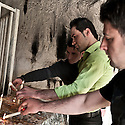 Iraq - Kurdistan - Ankawa -  Christians lighting some candles in a grotto beside St Elia Church