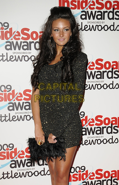 MICHELLE KEEGAN .Attending the Inside Soap Awards 2009,.Sketch, London, England, UK, September 27th 2009..arrivals half length black dress gold sparkly one sleeve clutch bag feathers feathered .CAP/CAN.©Can Nguyen/Capital Pictures.