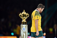 A dejected Adam Ashley-Cooper of Australia walks past the Webb Ellis Cup. Rugby World Cup Final between New Zealand and Australia on October 31, 2015 at Twickenham Stadium in London, England. Photo by: Patrick Khachfe / Onside Images