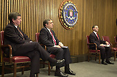 Washington, DC - February 20, 2001 -- U.S. Attorney General John Ashcroft, CIA Director George Tenet, and U.S. Federal Bureau of Investigation (FBI) Director Louis J. Freeh at a press conference where Freeh announced that veteran FBI counterintelligence Agent, Robert Philip Hanssen, was arrested on Sunday, February 18, 2001 at Foxstone Park in Vienna, Virginia and charged with committing espionage by providing highly classified national security information to Russia and the former Soviet Union..Credit: Ron Sachs / CNP
