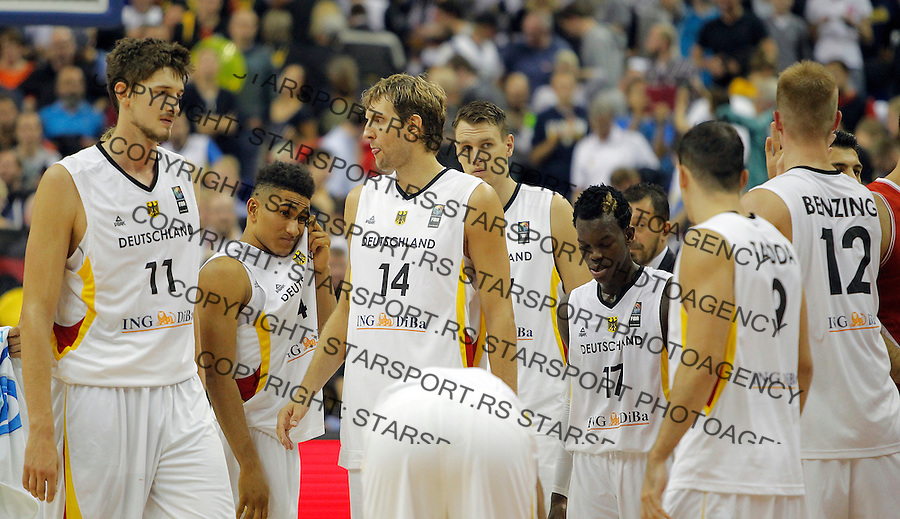 Germany's national basketball team players Tibor Pleiss, Dirk Nowitzki, Dennis Schroder Robin Benzing looks dejected after loosing against Turkey on  European championship group B basketball match on 08. September 2015 in Berlin, Germany  (credit image & photo: Pedja Milosavljevic / STARSPORT)