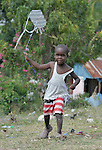 A boy flies a kite in a camp for homeless families in Jacmel, a town on Haiti's southern coast that was ravaged by the January 12 earthquake.